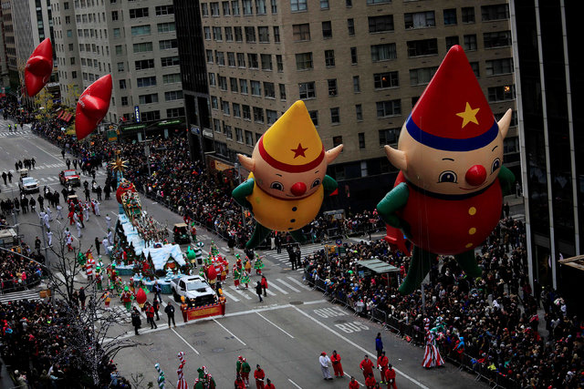 Macy's Elf balloons float above 6th Avenue during the 90th Macy's Thanksgiving Day Parade in the Manhattan borough of New York, U.S. November 24, 2016. REUTERS/Saul Martinez