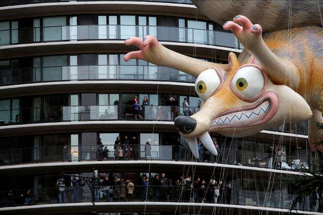Ice Age's Scrat balloon is carried by crowds gathered on terraces along West 59th Street during the 90th Macy's Thanksgiving Day Parade in Manhattan, New York, U.S., November 24, 2016.  REUTERS/An ...