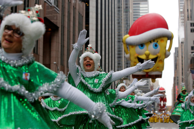 The Tap Dancing Christmas Trees perform on 6th Avenue during the 90th Macy's Thanksgiving Day Parade in Manhattan, New York, U.S., November 24, 2016.  REUTERS/Andrew Kelly