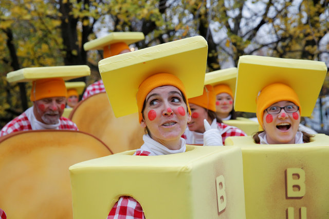 Clowns dressed as sticks of butter await the commencement of the 90th Macy's Thanksgiving Day Parade in Manhattan, New York, U.S., November 24, 2016.  REUTERS/Andrew Kelly