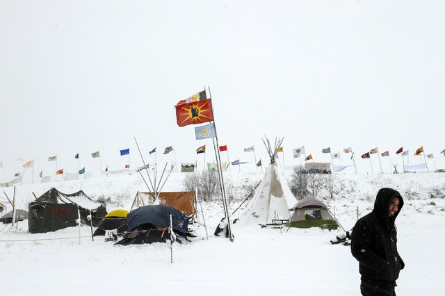 The Oceti Sakowin camp is seen in a snow storm during a protest against plans to pass the Dakota Access pipeline near the Standing Rock Indian Reservation, near Cannon Ball, North Dakota, Nov. 28, ...