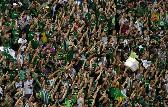 Soccer fans of Chapecoense celebrate after their victory in the Copa Sudamericana match against San Lorenzo at the Arena Conda stadium in Chapeco, Brazil, Nov. 23, 2016. (Paulo Whitaker/Reuters)
