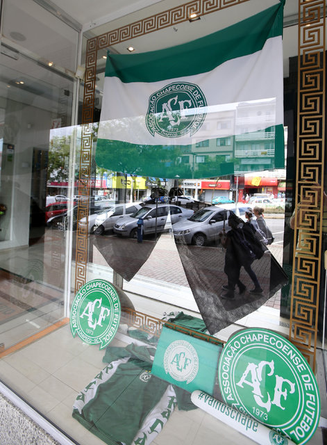 A shop window, is seen with a black ribbon in tribute to players of Chapecoense soccer team in Chapeco, Brazil, November 29, 2016. REUTERS/Paulo Whitaker