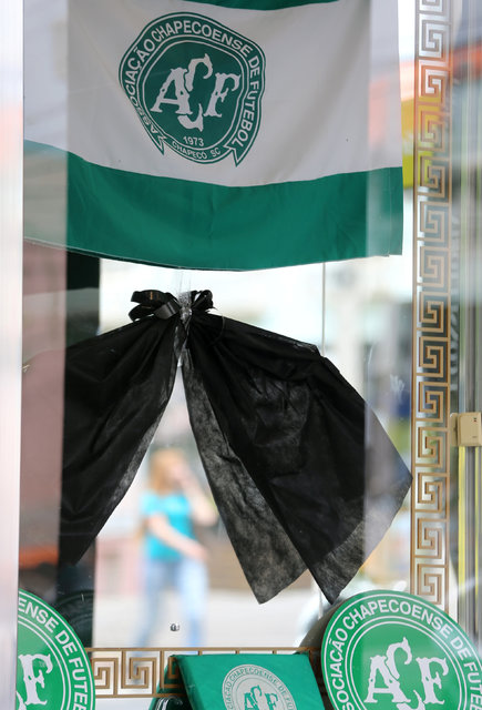 A shop window, is seen with a black ribbon in tribute to players of the Chapecoense soccer team in Chapeco, Brazil, November 29, 2016. REUTERS/Paulo Whitaker