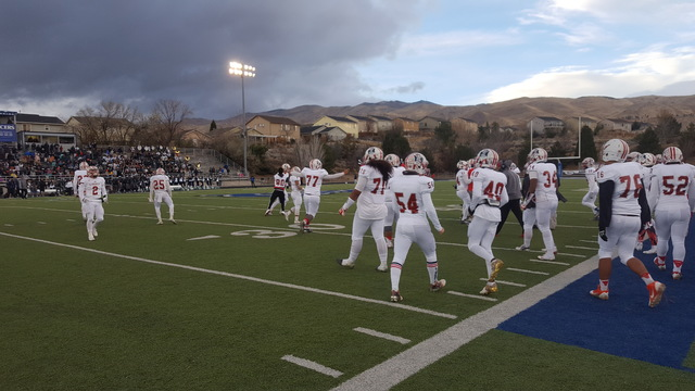 Liberty's football team celebrates after recovering a fumble in the fourth quarter of its 30-27 victory over Damonte Ranch in the Class 4A state semifinals Saturday at McQueen High in Reno. (David ...