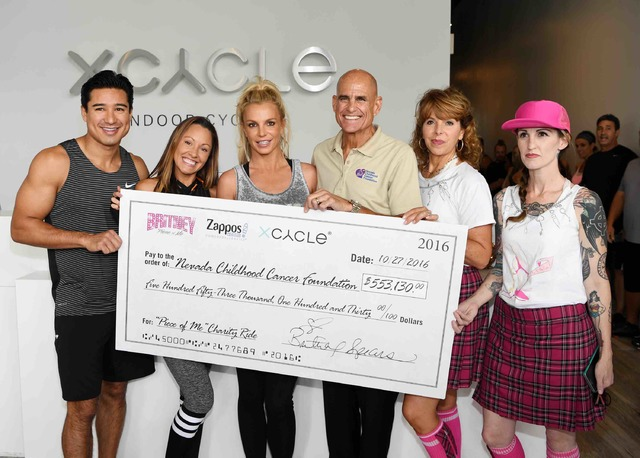Mario Lopez, left, and Britney Spears, third from left, at X Cycle on Thursday, Oct. 27, 2016, in Boca Park. (Courtesy)