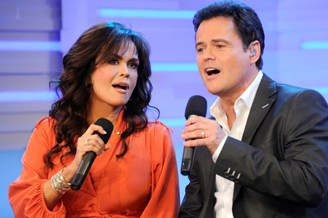 Donny & Marie Osmond are happy with Flamingo Las Vegas, and the wrap of their faces on the building. (Facebook photo)