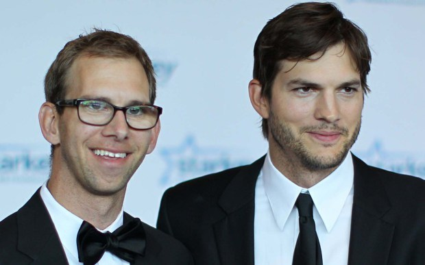 Actor Ashton Kutcher, right, and his twin brother, Michael Kutcher, arrive on the red carpet before the 2013 Starkey Hearing Foundation Gala in St. Paul, Minnesota. (Adam Bettcher/Getty Images)