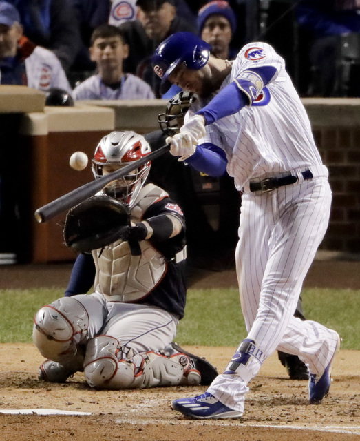 Chicago Cubs third baseman Kris Bryant hits a home run against the Cleveland Indians during the fourth inning of Game 5 of the Major League Baseball World Series Sunday, Oct. 30, 2016, in Chicago. ...