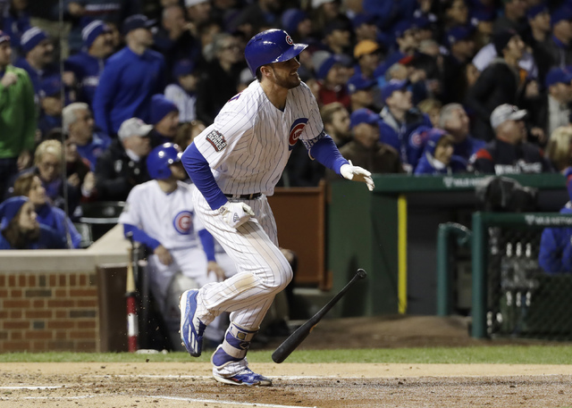 Chicago Cubs' Kris Bryant hits a home run during the fourth inning of Game 5 of the Major League Baseball World Series against the Cleveland Indians Sunday, Oct. 30, 2016, in Chicago. (David J. Ph ...