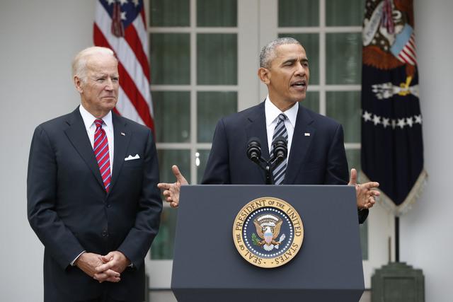President Barack Obama, accompanied by Vice President Joe Biden, speaks in the election, Wednesday, Nov. 9, 2016, in the Rose Garden of the White House in Washington. (Pablo Martinez Monsivais/AP)