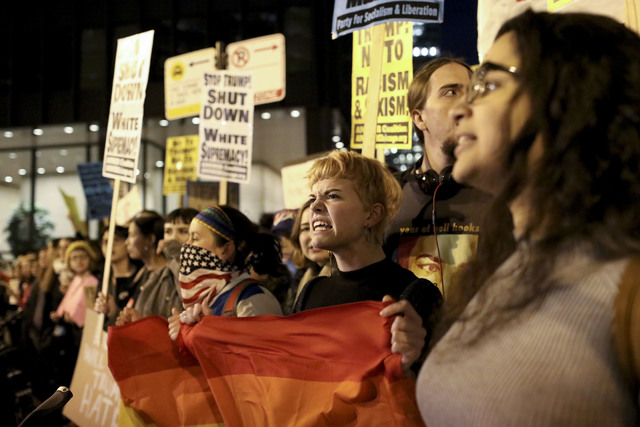 Protesters rally outside the Trump International Hotel and Tower, Wednesday, Nov. 9, 2016 in Chicago, Ill.,  in opposition of Donald Trump's presidential election victory. (Armando L. Sanchez/Chic ...