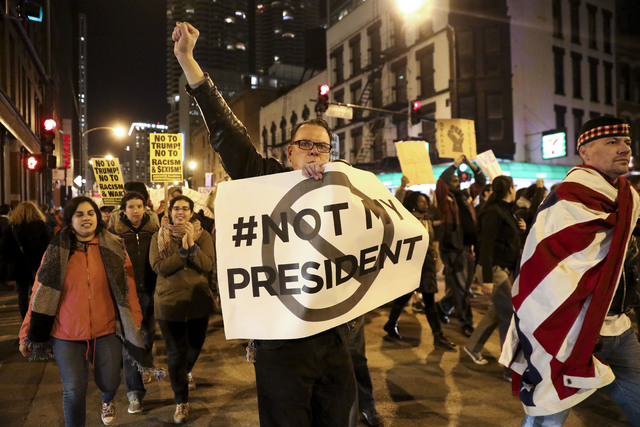 Protesters march North on State Street to express their disapproval of the election of Donald Trump as the 45th president of the United States, Wednesday, Nov. 9, 2016 in Chicago. (Armando L. Sanc ...
