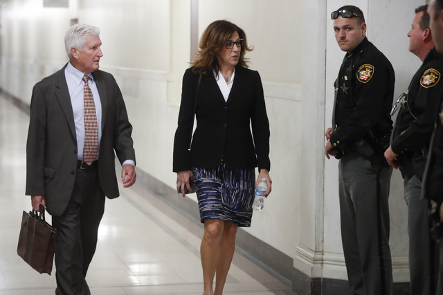 Stewart Mathews, left, and Gwen Callender, center, attorneys for Ray Tensing, arrive at court for the second time on the third day of jury deliberations in Tensing's murder trial, Friday, Nov. 11, ...