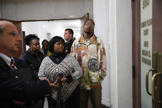 Terina Allen, Sam DuBose's sister, center left, waits outside of court on the third day of jury deliberations in the murder trial against Ray Tensing, Friday, Nov. 11, 2016, in Cincinnati. (John M ...