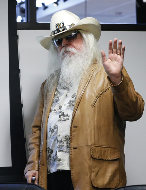 FILE - In this Jan. 29, 2013, file photo, Leon Russell waves as he is introduced in Tulsa, Okla. Russell, who sang, wrote and produced some of rock 'n' roll's top records, has died. (AP Photo/Sue  ...