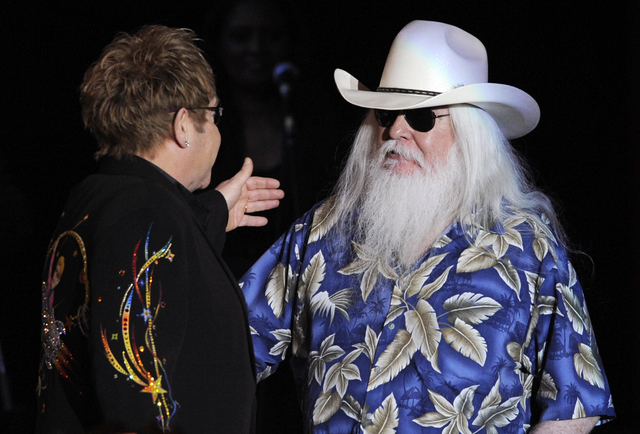 FILE - In this Nov. 3, 2010, file photo, Elton John, left, greets Leon Russell on the stage during their joint concert at the Hollywood Palladium in Los Angeles. Russell, who sang, wrote and produ ...