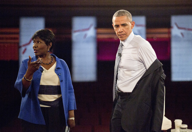 President Barack Obama removes his suit coat as he participates in a televised town hall event at Lerner Theatre in Elkhart, Ind., with PBS NewsHour co-anchor and manager editor Gwen Ifill, June 1 ...