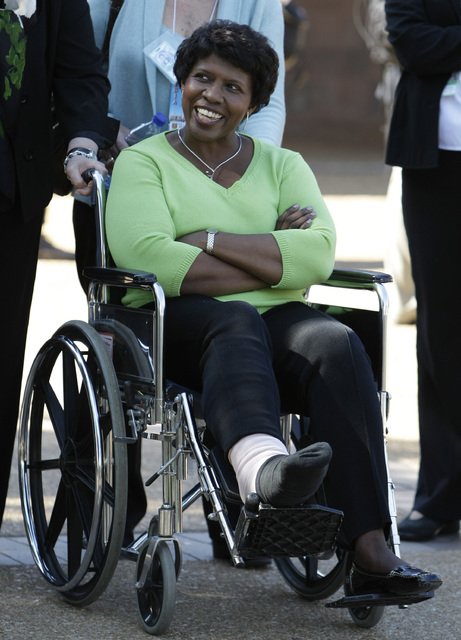 Debate moderator Gwen Ifill is wheeled into the site the vice presidential debate at Washington University in St. Louis, Oct. 2, 2008. (J. Scott Applewhite/AP)
