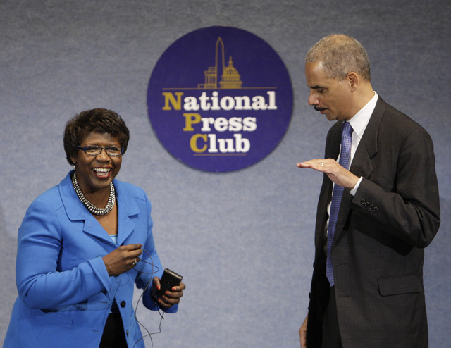 Then-Attorney General Eric Holder talks with Gwen Ifill during a NAACP Legal Defense and Educational Fund luncheon at the National Press Club in Washington, May 13, 2009. (Alex Brandon/AP)