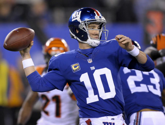 New York Giants quarterback Eli Manning (10) throws against the Cincinnati Bengals during the first quarter of an NFL football game, Monday, Nov. 14, 2016, in East Rutherford, N.J. (AP Photo/Bill  ...