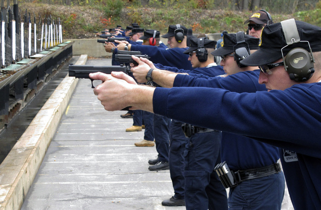 "Connecticut State Police recruits practice with their new .45-caliber Sig Sauer pistols during a ""dry fire"" exercise at the state police firing range in Simsbury, Connecticut. Some police departme ..."