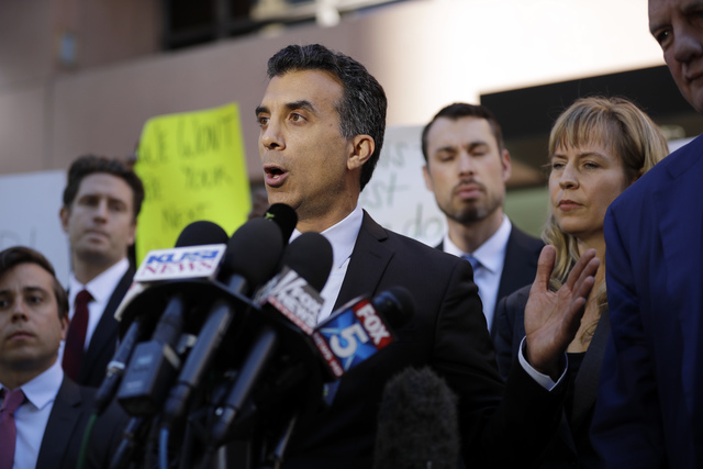 Plaintiff attorney Jason Forge speaks after a hearing for a lawsuit against President-elect Donald Trump and the now-defunct Trump University Friday, Nov. 18, 2016, in San Diego. Trump agreed Frid ...