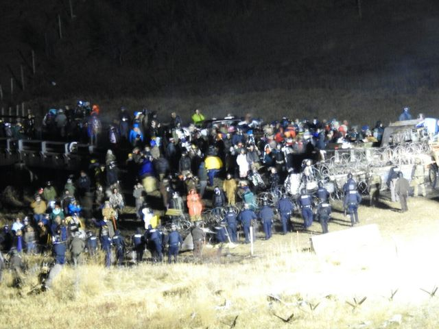 In this image provided by Morton County Sheriff's Department, law enforcement and protesters clash near the site of the Dakota Access pipeline on Sunday in Cannon Ball, North Dakota. The clash c ...