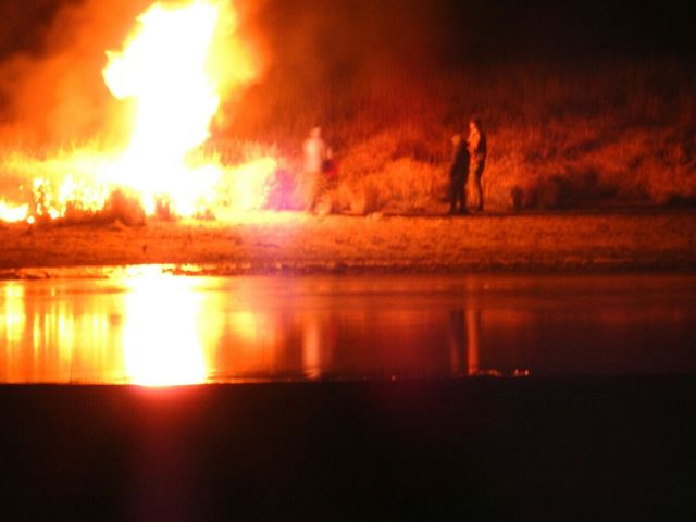 In this image provided by Morton County Sheriff's Department, law enforcement and protesters clash near the site of the Dakota Access pipeline on Sunday, Nov. 20, 2016, in Cannon Ball, N.D. ...
