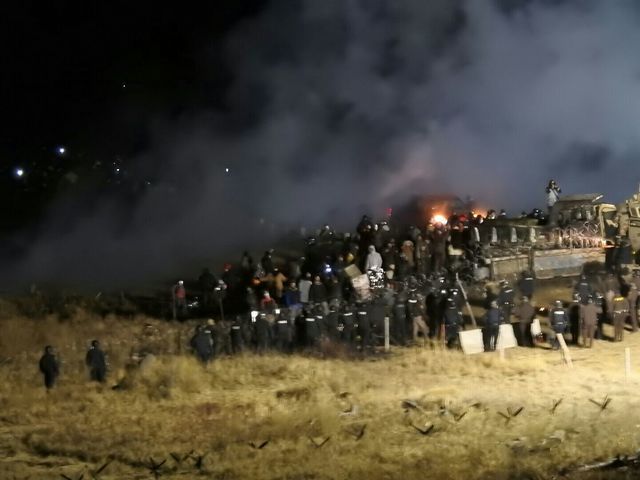 In this image provided by Morton County Sheriff's Department, law enforcement and protesters clash near the site of the Dakota Access pipeline on Sunday in Cannon Ball, North Dakota. At least on ...