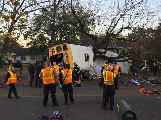 In this photo provided by the Chattanooga Fire Department via Chattanooga Times Free Press, Chattanooga Fire Department personnel work the scene of a fatal elementary school bus crash in Chattanoo ...
