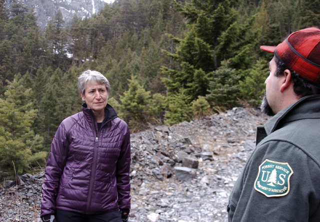 US Interior Secretary Sally Jewell, left, listens to a Forest Service official talk about the impacts of mining in the Absaroka Mountains near Pray, Mont., Monday, Nov.21, 2016.  Jewell on Monday  ...