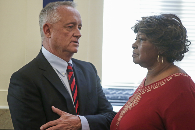 Hamilton County Prosecutor Joe Deters, left, speaks with Audrey DuBose, right, the mother of Sam DuBose, in a courtroom at the Hamilton County Courthouse in Cincinnati. (Carrie Cochran/The Cincinn ...
