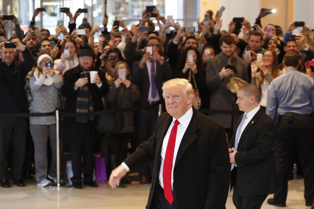 President-elect Donald Trump walks past a crowd as he leaves the New York Times building following a meeting, Tuesday, Nov. 22, 2016, in New York. (Mark Lennihan/AP)