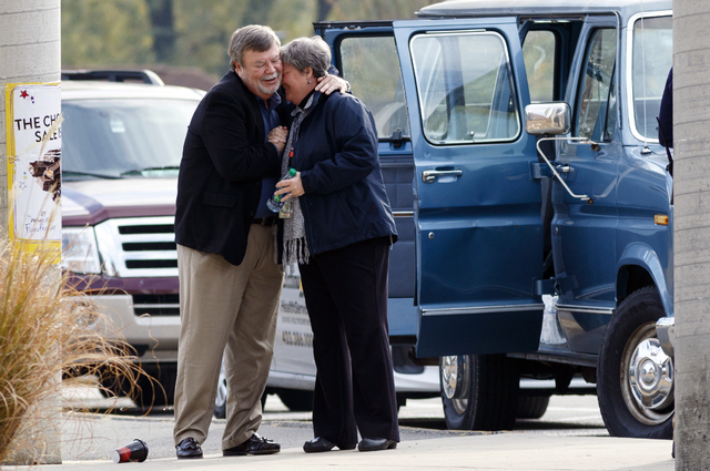 Unidentified volunteers embrace outside of Woodmore Elementary on Tuesday in Chattanooga, Tenn., after a school bus crash killed at least five children on Monday.  (Doug Strickland/Chattanooga Tim ...