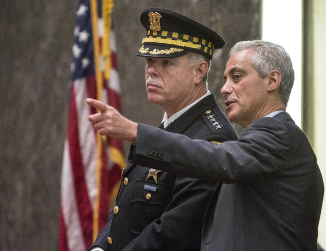 Chicago Police Supt. Garry McCarthy and Mayor Rahm Emanuel speak Oct. 6, 2015, in the City Council chambers in Chicago. This week marks the one-year anniversary of the release of the video showing ...