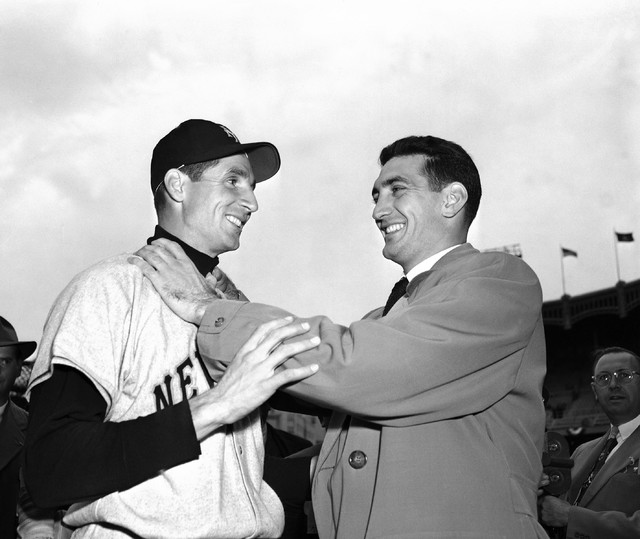 FILE - In this Oct. 10, 1951, file photo, Bobby Thomson, left, of the New York Giants, and Ralph Branca of the Brooklyn Dodgers, engage in horse play before a World Series game at Yankee Stadium i ...
