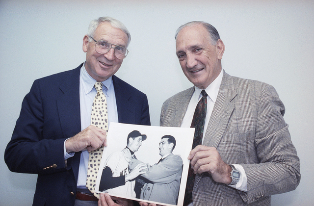 FILE - In this June 6, 1991, file photo, former New York Giants baseball player Bobby Thomson, left, poses with former Brooklyn Dodgers pitcher Ralph Branca holding a photo showing Branca, right,  ...
