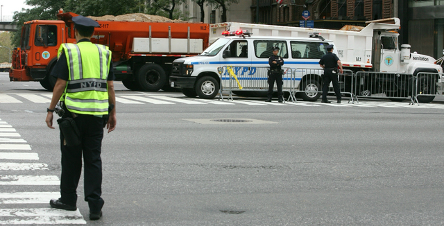 FILE- In this Sept. 22, 2009 file photo, a sanitation truck loaded with sand is used to block 42nd Street for increased security, one block from the United Nations as world leaders meet for the U. ...