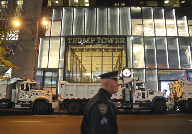 FILE- In this Nov. 8, 2016 file photo, Trump Tower, the primary residence of Republican presidential candidate Donald Trump, is blocked off by police and sanitation trucks in New York. More than 8 ...