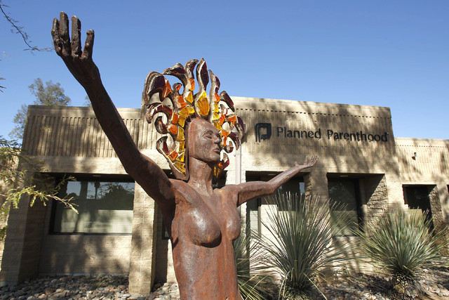 A statue representing women's empowerment stands in front of a Planned Parenthood facility Jan. 23, 2011, in Tucson, Ariz. The number and rate of abortions tallied by federal authorities have fall ...