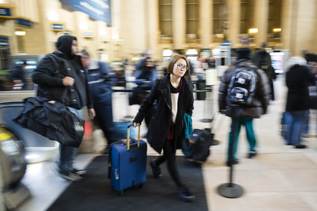 Travelers make their way through the 30th Street Station for the Thanksgiving Day holiday, in Philadelphia, Tuesday, Nov. 22, 2016. Almost 49 million people are expected to travel 50 miles or more ...