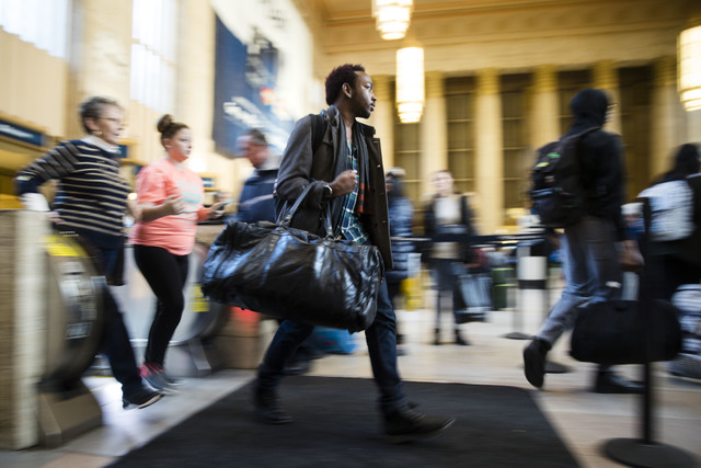 Travelers make their way through the 30th Street Station ahead of the Thanksgiving Day holiday, in Philadelphia, Tuesday, Nov. 22, 2016. Almost 49 million people are expected to travel 50 miles or ...