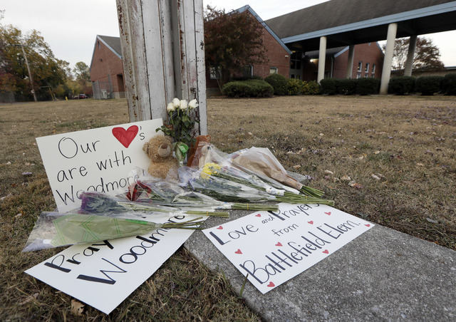 Flowers, signs and stuffed animals make up a makeshift memorial outside Woodmore Elementary School on Tuesday, Nov. 22, 2016, in Chattanooga, Tenn. The school bus driven by Johnthony Walker, 24, c ...