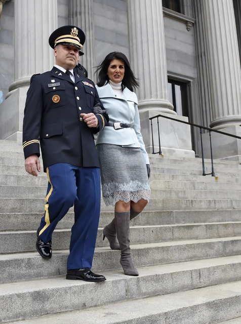 In this Jan. 14, 2015 file photo, South Carolina Gov. Nikki Haley is escorted down the steps of the Capitol by her husband Michael, in Columbia, S.C. President-elect Donald Trump has chosen Haley  ...