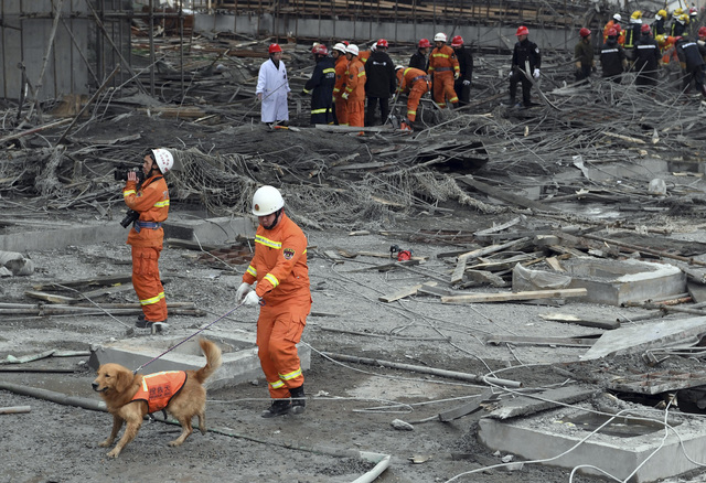 rescue workers look for survivors after a work platform collapsed at the Fengcheng power plant in eastern China's Jiangxi Province, Nov. 24, 2016. State media reported dozens were killed after the ...