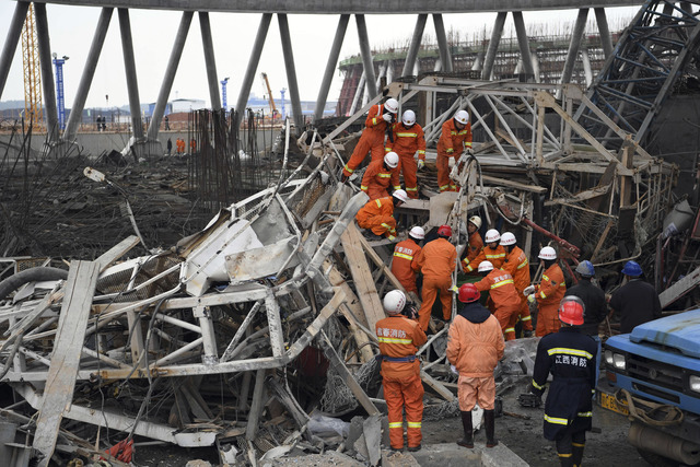 Rescue workers look for survivors after a work platform collapsed at a power plant in eastern China's Jiangxi Province. State media reported dozens were killed after the scaffolding tumbled down.  ...