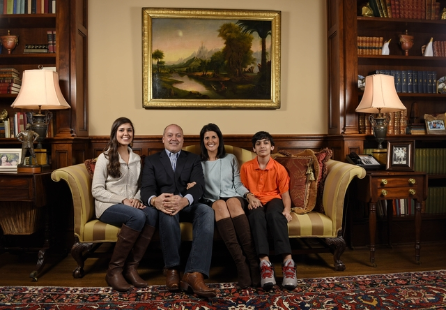 In this Jan. 8, 2015 photo, South Carolina Gov. Nikki Haley along with her family, husband Michael, daughter Rena, and son Nalin sit for a portrait in the drawing room of the Governor's Mansion, i ...