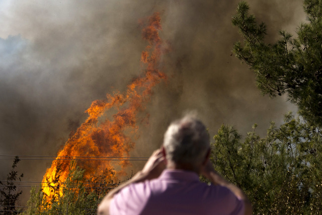A wildfire burns in Haifa, Israel, Thursday, Nov. 24, 2016. Israeli police have arrested four Palestinians in connection with one of several large fires that damaged homes and prompted the evacuat ...