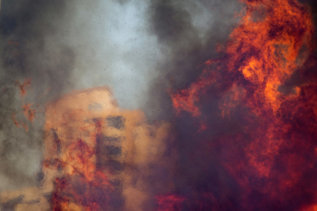A wildfire rages in Haifa, Israel, Thursday. The blaze ripped through parts of Israel's third-largest city, forcing tens of thousands of people to evacuate their homes. (Ariel Schalit/AP)